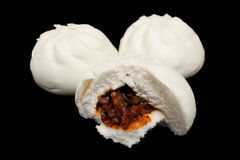 Chinese Barbecued Pork Bun (Cha Siu Baau). Two and half white Chinese barbecued pork bun (Cha Siu Baau) isolated on black background Royalty Free Stock Image