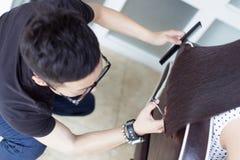 Chinese barber trim long hair Royalty Free Stock Photo