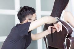 Chinese barber trim long hair Royalty Free Stock Photos
