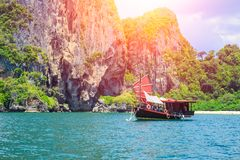 Chinese barque boat at Thailand summer travel sea. Thai old wood boat at sea beach Krabi Phi Phi Island Phuket park on white sand blue sky emerald green ocean stock photo