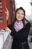 Chinese beautiful girl with window Royalty Free Stock Photo