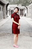 Chinese beauty in the alley. Chinese beauty in traditional cheongsam standing in the ancient  alley Stock Image