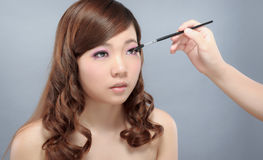 Chinese beauty applying make up Stock Image