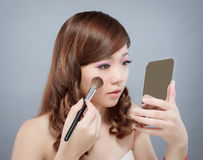 Chinese beauty applying make up Stock Photography