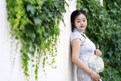 Chinese beauty in cheongsam enjoy free time Stock Images
