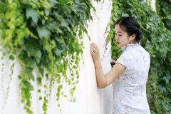 Chinese beauty  in cheongsam enjoy free time Royalty Free Stock Images