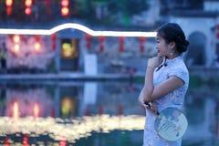 Chinese beauty in cheongsam enjoy free time Stock Photos