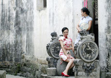 Chinese beauty  girlfriends in cheongsam enjoy free time Royalty Free Stock Images