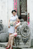 Chinese beauty  girlfriends in cheongsam enjoy free time Stock Photos