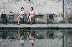 Chinese beauty  girlfriends in cheongsam enjoy free time Stock Photo
