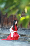 Chinese beauty has a rest on a step Royalty Free Stock Photography
