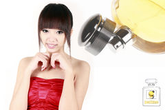 Chinese beauty with perfume. On white Royalty Free Stock Image