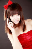 Chinese beauty on phone Stock Photography