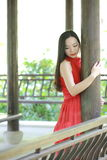 Chinese beauty relaxing in a park and enjoy her vactaion Stock Photo