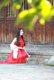 Chinese beauty relaxing on a step Royalty Free Stock Photography