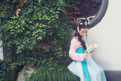 Chinese girl in traditional ancient drama costume hanfu cosplay. Chinese beauty in traditional ancient costume, hold a fan on hand, elegant people, Close royalty free stock photography