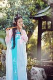 Chinese beauty in traditional ancient drama costume play flute Stock Photo