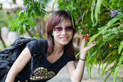 Chinese beauty woman. With black T-shirt and sunglass Royalty Free Stock Photo