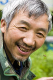 Chinese bee farmer. A  Chinese bee farmer is smiling Royalty Free Stock Photos
