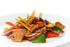 Chinese beef and vegetables. Typical chinese dish,fresh beef stir fried with pepperrs bamboo sprout and mushrooms Stock Photography