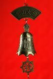 Chinese bell with buddha. In red background Stock Image