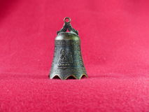 Chinese bell. On a red background Royalty Free Stock Photo