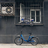Chinese bike-share mode. Beijing,China - May 24th,2017:Bike-share mode is changing people's life.Uper bicycle is private,lower one is bicycle for share Royalty Free Stock Image