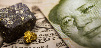 Chinese bill, minerals & map of Africa Royalty Free Stock Photo