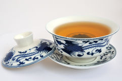 Chinese blue Painting tea cup and tea. A set of Chinese blue painting tea cup and tea, which refer to chinese traditional culture and tea culture Stock Photo