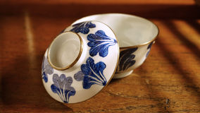 Chinese blue and white ceramic bowl on wooden table Stock Photo