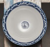 Chinese blue and white porcelain empty bowl. 。On a mottled wood board. It is overcast Stock Photos