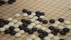 Chinese board game Go or Weiqi. With black and white stones Royalty Free Stock Images