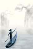 Chinese boat. In the mist. Mountains and trees are seen far away Royalty Free Stock Images