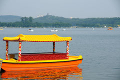 Chinese boat on lake. Traditional chinese boat drifting on a lake Royalty Free Stock Photo