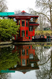 Chinese boat restaurant London. A floating chinese restaurant on a canal in London, UK. A longboat is seen in the distance Royalty Free Stock Image