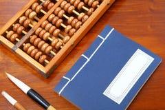 Chinese boek, telraam en het schrijven borstel Royalty-vrije Stock Afbeelding