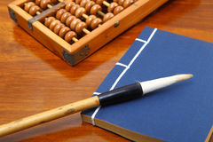 Chinese book and abacus Stock Photography