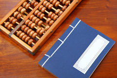 Chinese book and abacus Royalty Free Stock Images