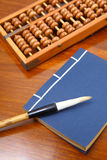 Chinese book , abacus and writing brush Stock Image
