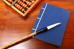 Chinese book , abacus and writing brush Royalty Free Stock Photos