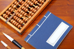Chinese book , abacus and writing brush Royalty Free Stock Image
