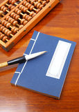 Chinese book , abacus and writing brush Royalty Free Stock Photography
