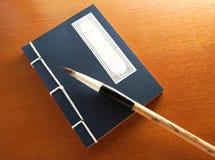 Chinese book and writing brush Stock Photo