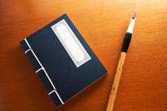 Chinese book and writing brush Stock Image