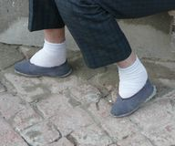 Chinese bound feet. 70 year old 57 lady in 2006 who had feet bound as a child in China royalty free stock photography