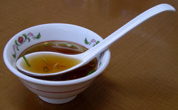 Chinese bowl. A Chinese bowl with soup and specific spoon Royalty Free Stock Photos