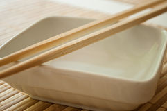 Chinese bowl with Chinese chopsticks Stock Images