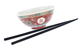 Chinese bowl with chinese sticks. Bowl painted in chinese style with 2 chinese eating sticks Royalty Free Stock Photography