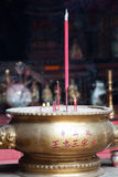Chinese bowl with incense. Incense sticks are burning in Chinese Temple in Saigon (Ho Chi Minh), Vietnam Royalty Free Stock Photo