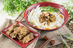 Chinese bowl of noodle with fried pork ribs and herbs on the tab Stock Photos